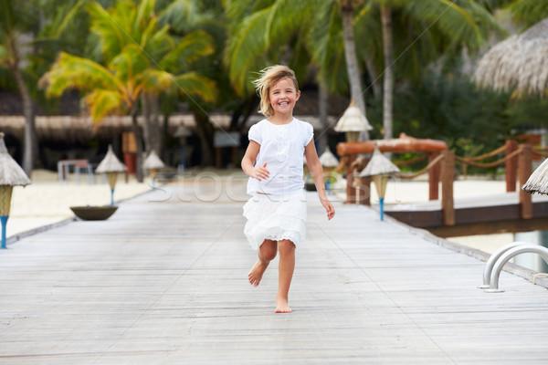 Child Running Along Wooden Jetty Stock photo © monkey_business