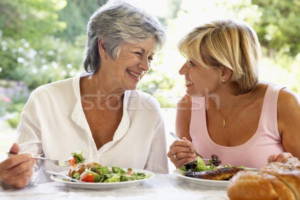 Friends Eating An Al Fresco Meal Stock photo © monkey_business