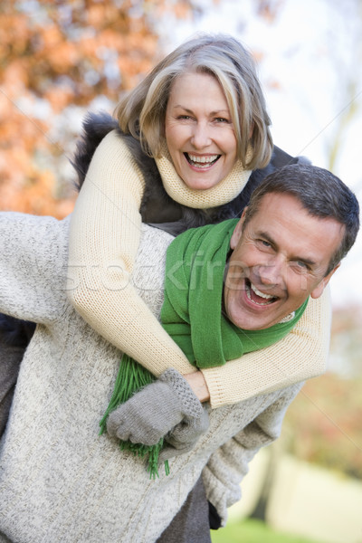 Senior uomo donna piggyback autunno boschi Foto d'archivio © monkey_business