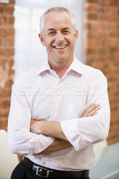 Businessman standing in office laughing Stock photo © monkey_business