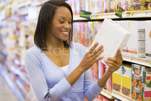 Woman checking food labelling in supermarket Stock photo © monkey_business