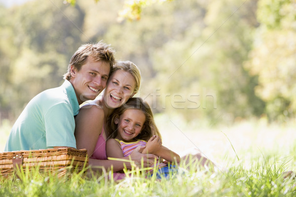 Family at park having a picnic and laughing Stock photo © monkey_business