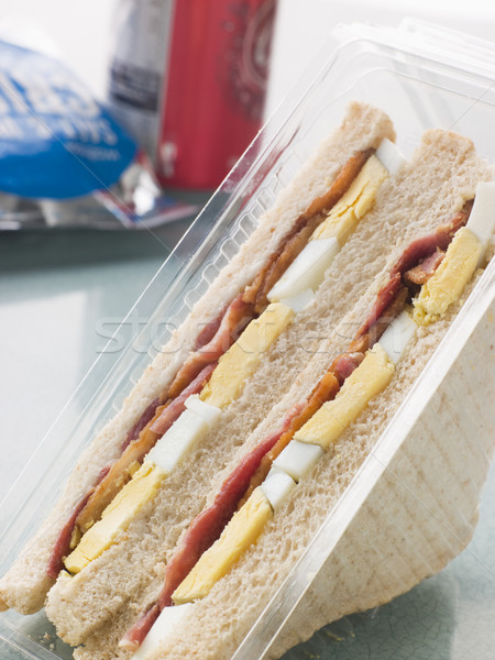 Egg And Bacon Sandwich On White Bread With A Bag Of Crisps And A Stock photo © monkey_business