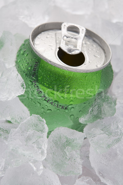 Green Can Of Fizzy Soft Drink Set In Ice With The Ring Pulled Stock photo © monkey_business