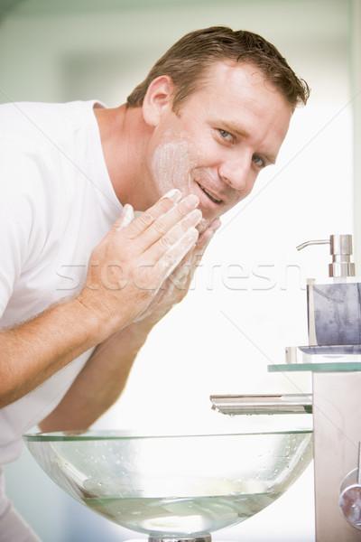 Hombre bano lavado cara sonriendo ropa interior Foto stock © monkey_business