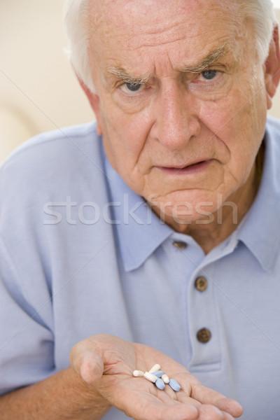 Senior Man Holding Prescription Drugs Stock photo © monkey_business