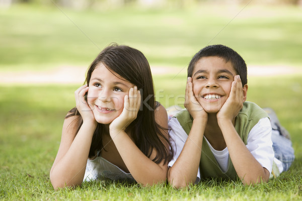 Two children relaxing in park Stock photo © monkey_business