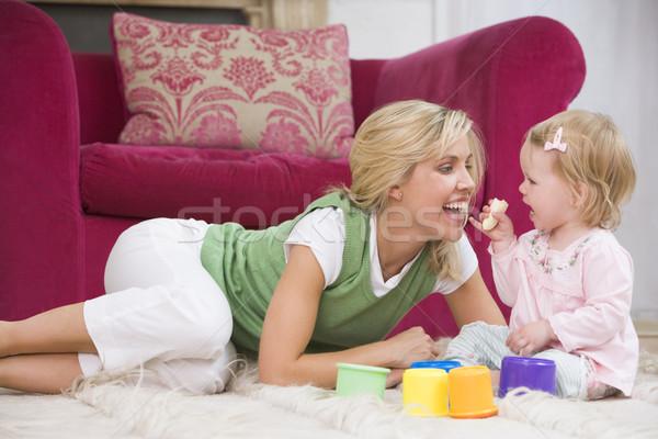 Anya nappali baba eszik banán mosolyog Stock fotó © monkey_business