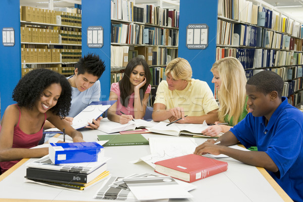 Group of university students working in library Stock photo © monkey_business