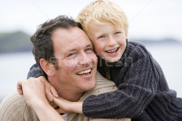 Stock photo: Father and son at beach smiling