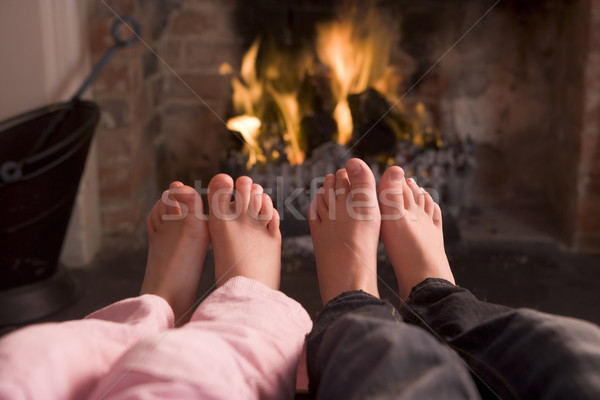 Couple's feet warming at a fireplace Stock photo © monkey_business