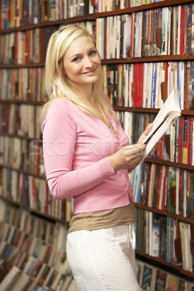 Female customer in bookshop Stock photo © monkey_business
