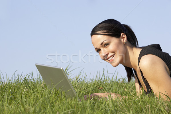 Woman Using Laptop Outdoors In Summer Countryside Stock photo © monkey_business