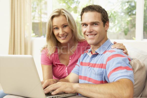 Stock fotó: Fiatal · pér · laptopot · használ · otthon · férfi · boldog · laptop