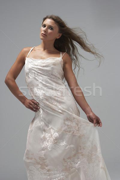 Teljes alakos stúdiófelvétel fiatal nő fehér estélyi ruha nő Stock fotó © monkey_business
