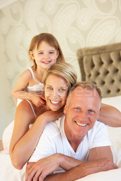 Family Relaxing In Bedroom Stock photo © monkey_business