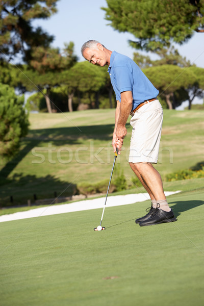 Senior Male Golfer On Golf Course Putting On Green Stock photo © monkey_business