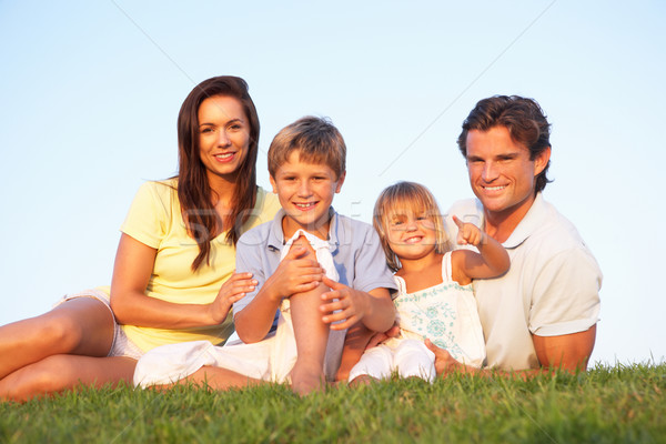 Young parents, with children, posing on a field Stock photo © monkey_business