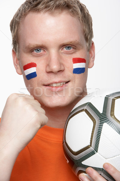 Young Male Football Fan With Dutch Flag Painted On Face Stock photo © monkey_business