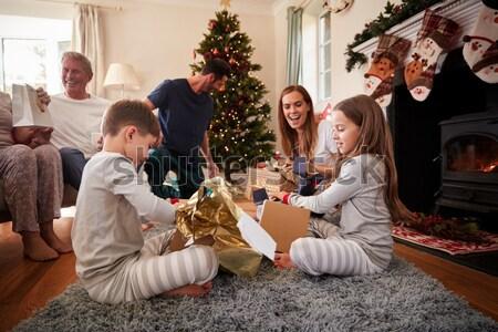 Hispanic family exchanging gifts at Christmas Stock photo © monkey_business