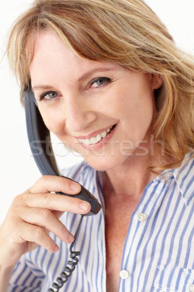Stock photo: Mid age businesswoman on phone