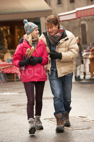 Couple Walking Along Snowy Town Street In Ski Resort Stock photo © monkey_business