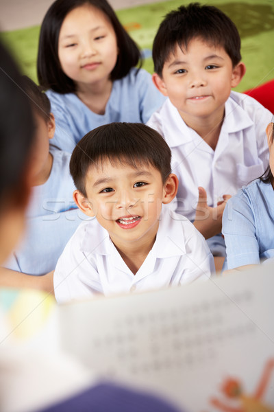 Maestro lectura estudiantes chino escuela aula Foto stock © monkey_business