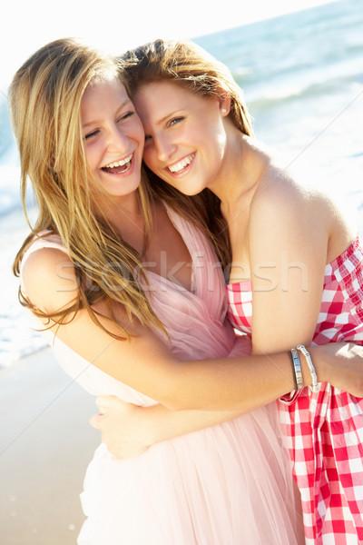 Two Teenage Girls Enjoying Beach Holiday Together Stock photo © monkey_business