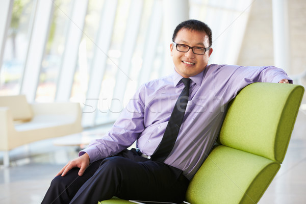 Portrait Of Businessman Sitting On Sofa In Modern Office Stock photo © monkey_business