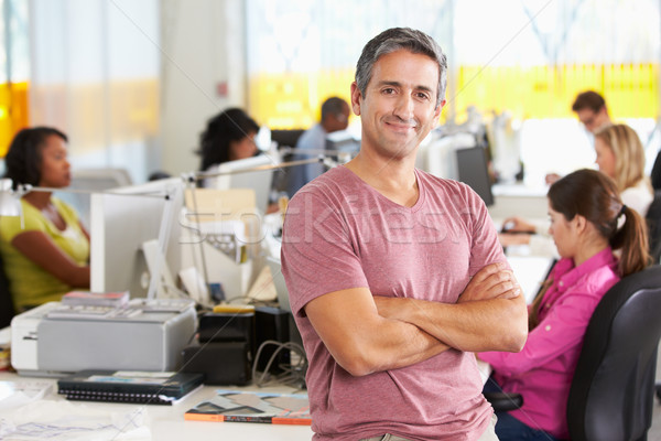 Portrait Of Man Standing In Busy Creative Office Stock photo © monkey_business