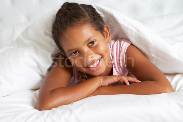 Young Girl Hiding Under Duvet In Bed Stock photo © monkey_business