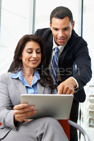 Digital tableta informal reunión negocios Foto stock © monkey_business