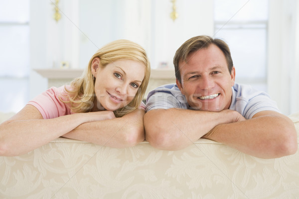 Couple relaxing in living room and smiling Stock photo © monkey_business