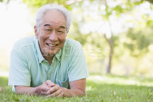 Man relaxing outdoors smiling Stock photo © monkey_business