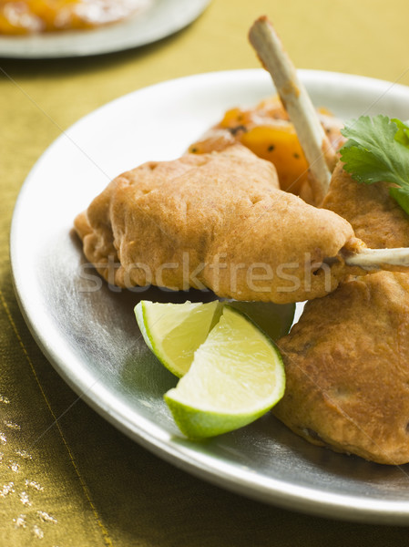 Stock photo: Kashmiri Lamb Cutlets with Lime Wedges and Mango Chutney