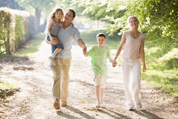 Stock photo: Family walking outdoors holding hands and smiling
