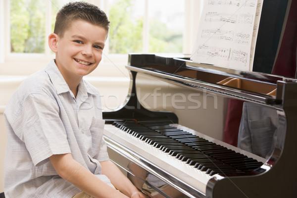 Boy Playing Piano Stock photo © monkey_business