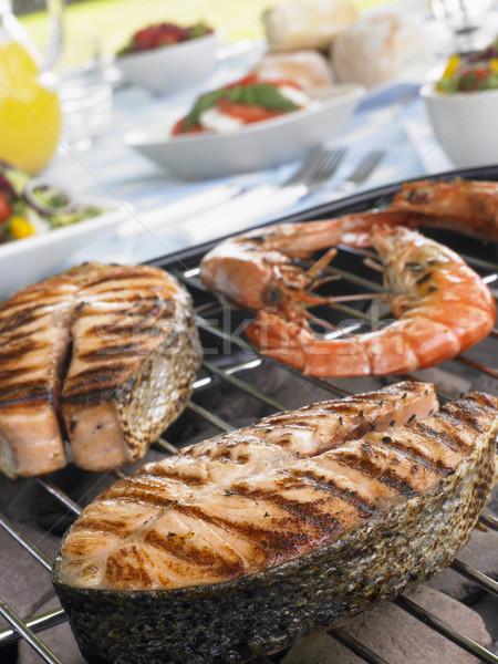 Salmon And Prawns Cooking On A Grill Stock photo © monkey_business