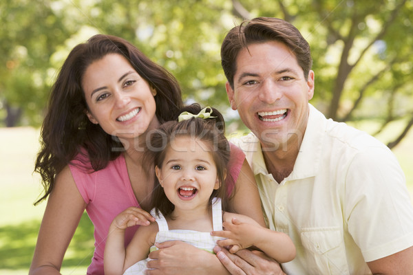 Family sitting outdoors smiling Stock photo © monkey_business