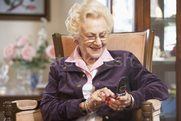 Senior woman text messaging Stock photo © monkey_business