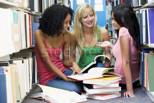 üç Öğrenciler kütüphane kadın oturma Stok fotoğraf © monkey_business