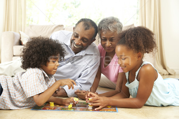 Stock photo: Grandparents Playing Board Game At Home With Grandchildren