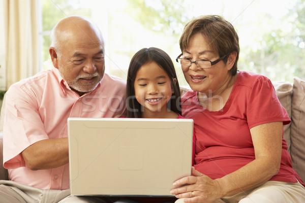дедушка и бабушка используя ноутбук компьютер домой девушки человека Сток-фото © monkey_business