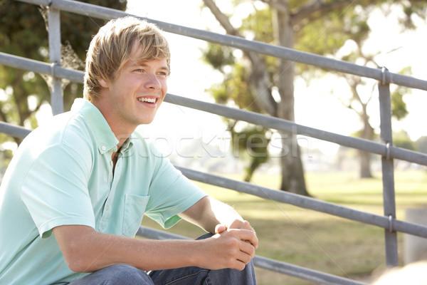 Tizenéves fiú ül játszótér férfi boldog tini Stock fotó © monkey_business