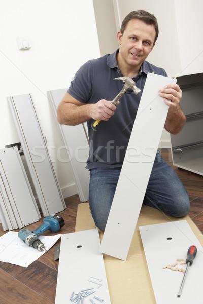 Man Assembling Flat Pack Furniture Stock photo © monkey_business