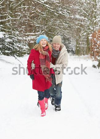 Young Girl With Grandmother Holding Sledge In Snowy Landscape Stock photo © monkey_business