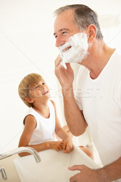 Grandson Watching Grandfather Shaving In Bathroom Mirror Stock photo © monkey_business