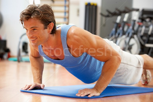 Man Doing Press Ups In Gym Stock photo © monkey_business