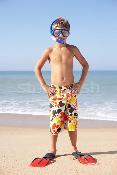 Young boy poses on beach Stock photo © monkey_business