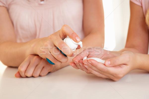 Woman hand applying hand sanitizer Stock photo © monkey_business
